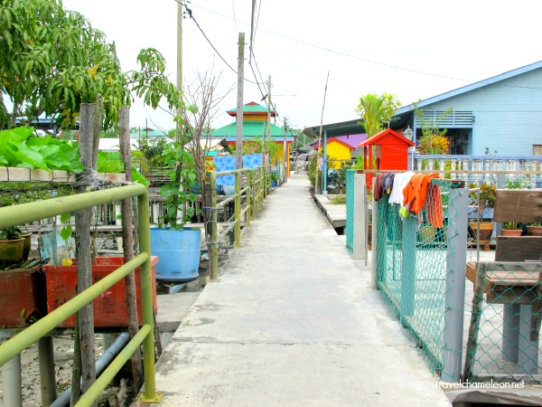 The road leads you to colourful homes on the island.