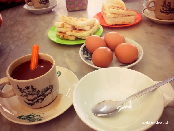 Half boiled egss and toasted bread at the corner kopitiam.