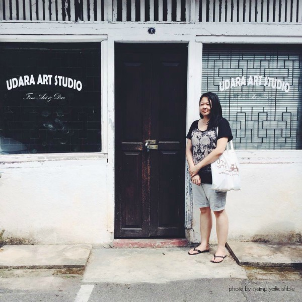 The lovely bride to be in front of a creative studio found on Jonker Street.