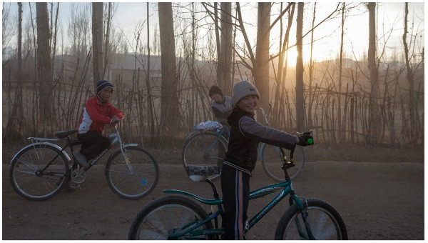 Children cycling in Kyrgyzstan.