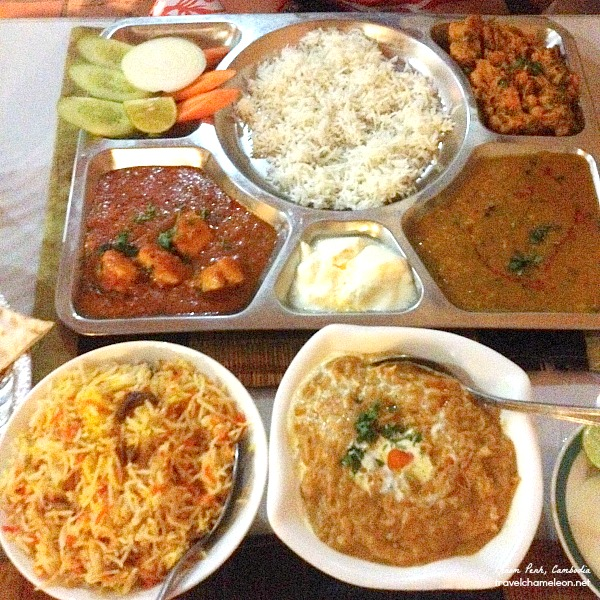 Chicken curry with briyani rice and a set of vegetarian thali for dinner in Madras.