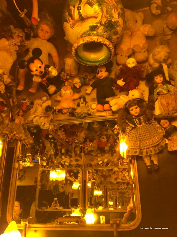 Dolls and soft toys hang on the ceiling in one of the local restaurants.