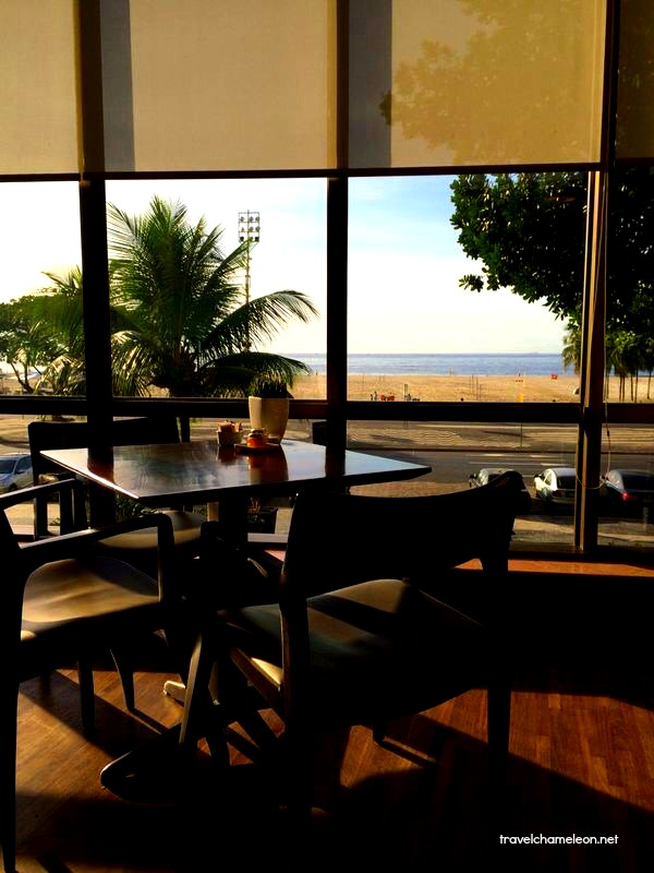 Having breakfast with a view of the beach.