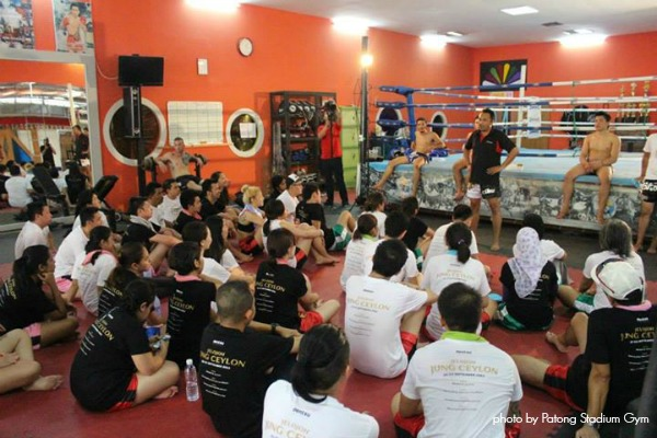 Listening to the briefing by the Muay Thai trainers.