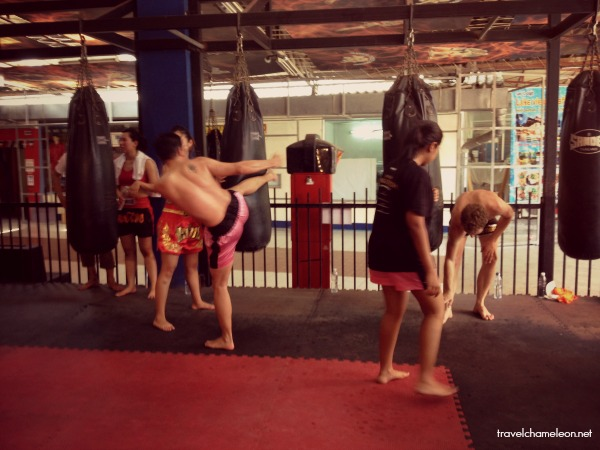 Training with the punching bags with kicks and punches.