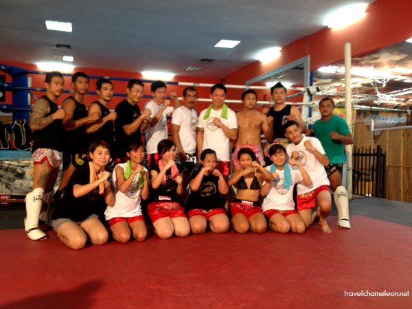 Posing with the trainers who are also professional Muay Thai fighters.