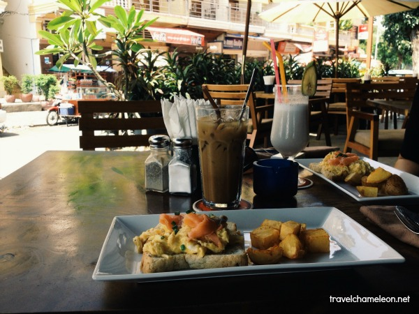 Eggs with salmon, vegetable pizza and iced Khmer coffee with milk is nice here at the Grand River Restaurant.