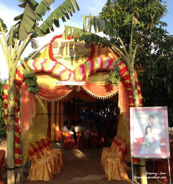 Main entrance to the wedding with banana trees in front.