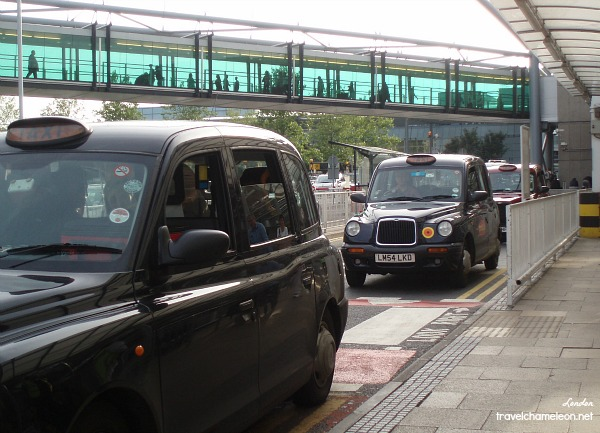 Cute London black cabs waiting at the airport.