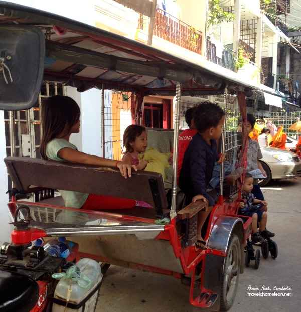 Kids using the tuk tuk as their playground this morning.