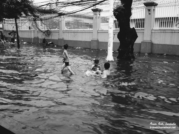 Children taking advantage of the rainy season in the city centre.