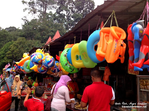 Locals buying floats for their children to swim in the river.