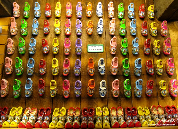 Colorful clogs on the wall and everywhere in the workshop.