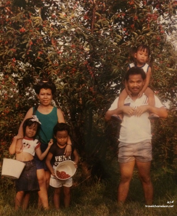 Picking cherries with the family somewhere in America.