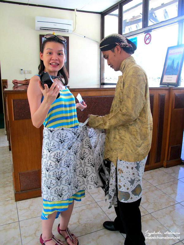 My friend SS getting her sarong tied before we enter the complex.