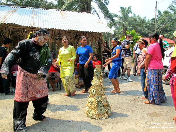 The priest dancing to the music with the villagers.