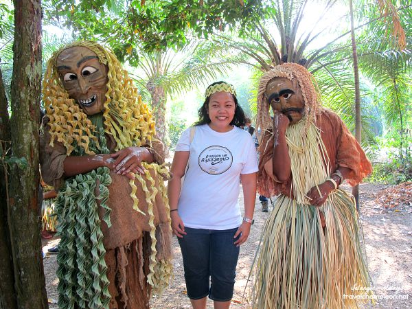 Posing with the Mah Meri tribesmen in their leaf skirts and masks.