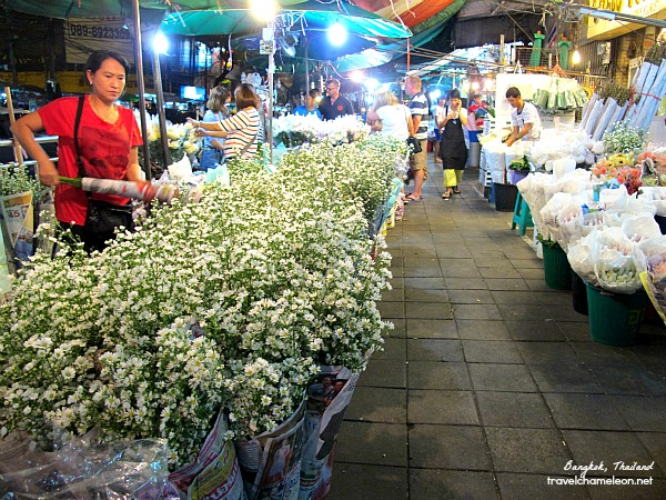 The Bangkok flower market begins and ends with a row of flowers.
